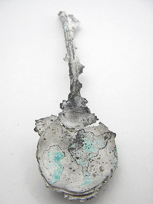 Cast silver teaspoon
