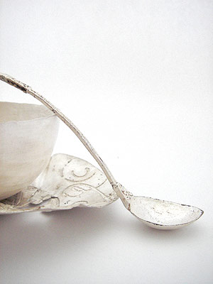 Silver bowls, silver spoon, silver saucer