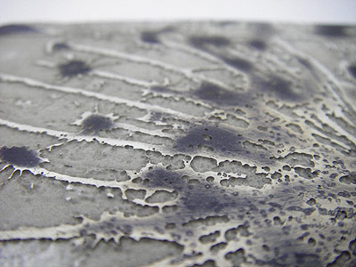 Detail of acid etched silver